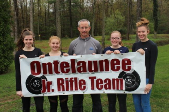 Four members of the Ontelaunee Junior Rifle Team recently competed at the Junior Olympics in Colorado. From left are Jeanne Haverill, Madilyn Riegel, Coach Tom Fister, Calista Smoyer and Emma Rhode. LISA PRICE/SPECIAL TO THE TIMES NEWS