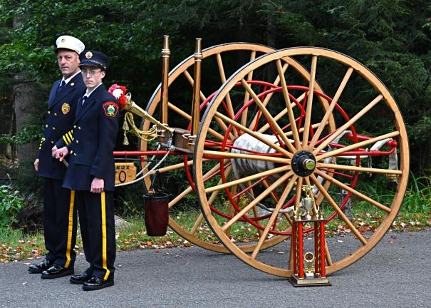 VICTOR IZZO/SPECIAL TO THE TIMES NEWS Steve Lilick, the assistant fire chief of the Albrightsville Fire Company and his son Nicholas stand parade-ready with the 1860 Wirt & Knox hand-drawn hose cart that he has painstakingly restored over a period…