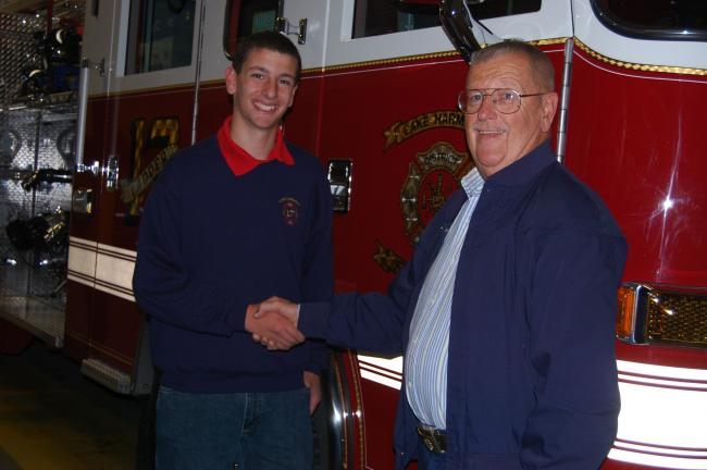 elsa kerschner/TIMES NEWS Junior firefighter Dan Plavin, left, receives congratulations from Ralph Lennon, chief of the Lake Harmony Fire Company.