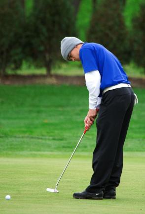 BOB FORD/TIMES NEWS Mike Englert of Palmerton rolls a putt at the District 11 golf championships.