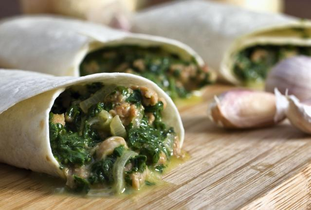 This photo taken Aug. 30, 2009 shows a spicy sausage wrap. Flexible and filling Spicy Sausage Wraps with Golden Onions and Spinach are an easy and economical complete meal. (AP Photo/Larry Crowe)