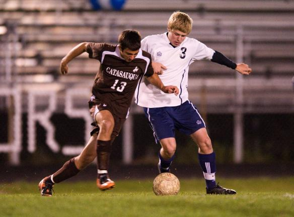 BOB FORD/TIMES NEWS Catasauqua's Nick Squires (left) goes after the ball as Northern Lehigh's Channing Shiffert moves in to defend.