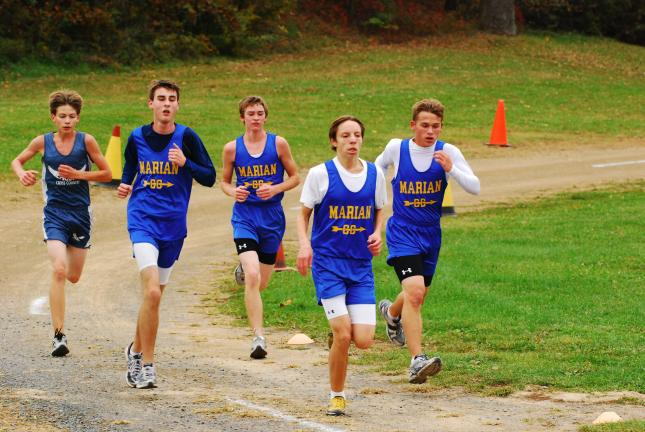 DAN FRANK/TIMES NEWS A group of Marian runners and one from Blue Mountain stay together during Wednesday's Schuylkill League championship match. From right are the Colts' Connor Schleicher, Michael Legath, Phillip Marzen and David Paul.