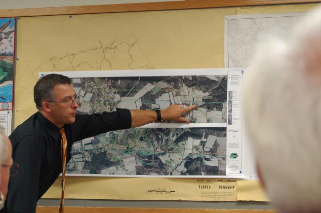 LINDA KOEHLER/TIMES NEWS George Basila, a GIS analyst with the Monroe County Planning Commission points out one of the disputed boundary lines between Polk and Eldred townships for the Eldred Township supervisors.