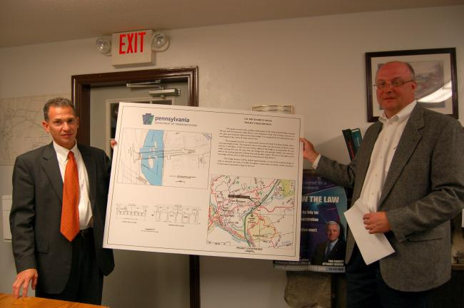 GAIL MAHOLICK/TIMES NEWS PennDOT engineers David Marchese, left, lead engineer, of Wilbur Smith Associates of Harrisburg, and Michael J. Girman III, project manager, of DMJM of Philadelphia, presented information about the proposed construction of a…