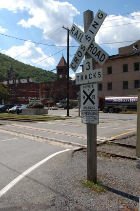 FILE PHOTO The triple track crossing outside the Carbon County parking lot in Jim Thorpe will be replaced over the new two week. The main entrance to the lot, seen here, will be shut down to vehicular traffic beginning Monday and redirected to a…
