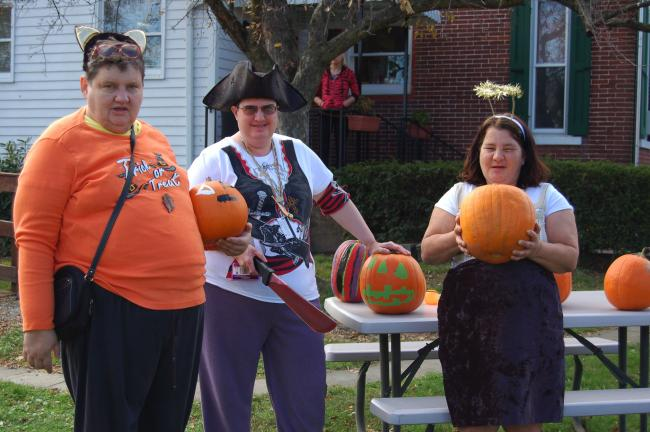 CHRIS PARKER/TIMES NEWS Clients of Spectrum Community Services, Lehighton, had a grand time at aHalloween party Thursday. Costumed guests fromNesquehoning and Lehigh Countydecorated pumpkins, enjoyed snacks and had their facespainted. Here, Mary G…