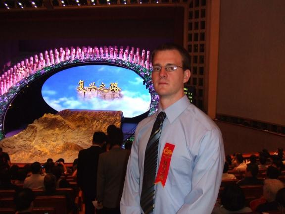 Press photo by BRANDON TAYLOR Foreign expert Brandon Taylor prior to the start of an operatic performance of New China's 60-year history in the Great Hall of the People, the legislative building of the Chinese government.