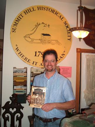 "DAVID WARGO/SPECIAL TO THE TIMES NEWS Local author Lee Mantz holds an advanced copy of his newly published book ""Summit Hill"" released today by Arcadia Publishing. Inspired by his collection and involvement with the Summit Hill Historical Society,…"