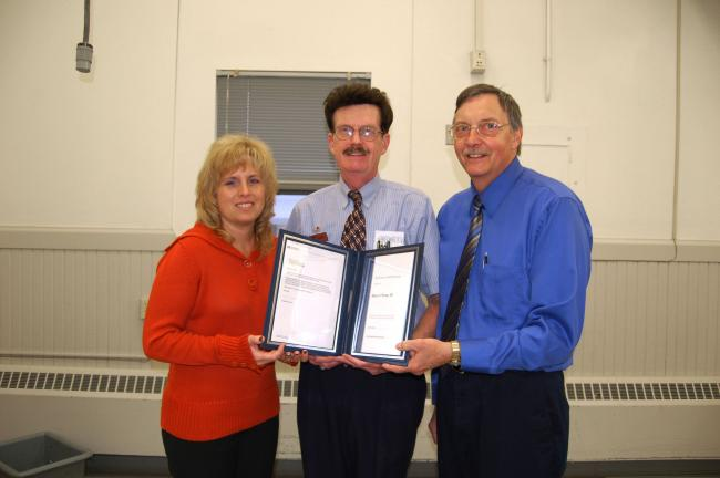 Gail Maholick/TIMES NEWS Harry Wynn III, 61, of Lehighton officially retired from the U.S. Postal Service. His last position was serving as a clerk at the Lehighton Post Office. From left are, Christine McAvoy, postmaster; Wynn; and William Maehrer,…
