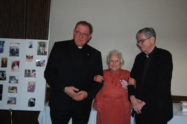 ELSA KERSCHNER/SPECIAL TO THE TIMES NEWS The Rev. Joseph Grembocki and Monsignor James Mulligan of Assumption BVM Roman Catholic Church in Slatington attended the 100th birthday celebration to honor Elisa Delgreco.