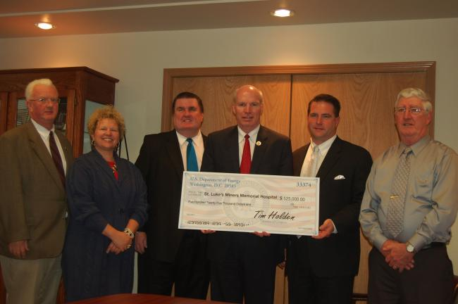 JOE PLASKO/TIMES NEWS Congressman Tim Holden, center, presented officials at St. Luke's Miners Memorial Hospital with a $525,000 check to support the hospital's Energy Efficiency Improvement Project today. Joining Holden are, from left to right,…