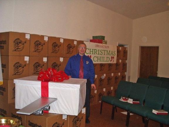 TIMES NEWS FILE PHOTO The Rev. Robert Johnson with a collection of shoe boxes from a past Operation Christmas Child drive.