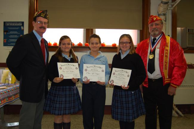 Gail Maholick/TIMES NEWS Winners of Lehighton VFW Post 256 Patriot's Pen Essay Contest at Ss. Peter and Paul School were presented awards by Harry Wynn, contest chairperson and past post commander, left; and Fred Schaffer, quartermaster, right…