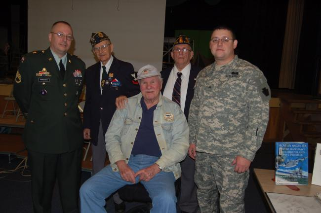 TERRY AHNER/TIMES NEWS Veterans who shared their stories with Palmerton Area High School students during an assembly Monday morning include (front row, seated) Earl Henning, and Timothy Kromer, and in the back row (l-r) Chuck Franisco, Al Kohler,…