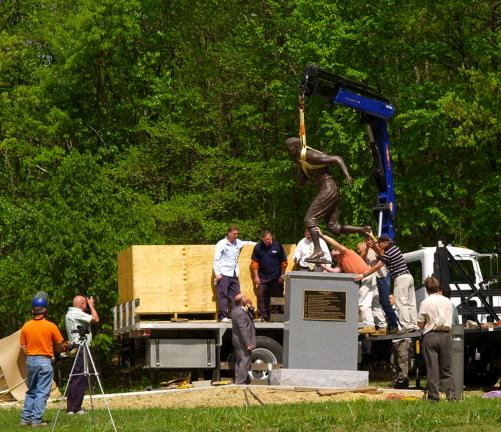 FILE PHOTO The bronze statue of Jim Thorpe is lowered onto a granite pedestal at the Jim Thorpe Memorial in the Borough of Jim Thorpe several years ago. A lawsuit threatens to remove Thorpe's remains to his family home in Oklahoma.