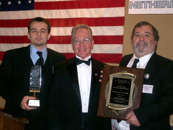 SPECIAL TO THE TIMES NEWS Mountain Karate Academy was presented two awards by the Eastern USA International Martial Arts Association. From left are, Master Paul Maglionico, Grandmaster John Kanzler, presenter; and Kyo Sa Nim Rich Maglionico.