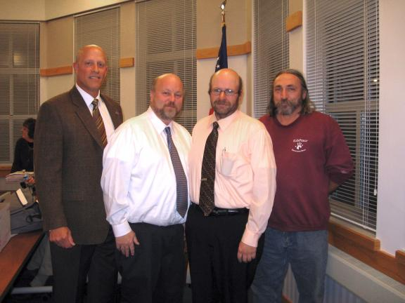 STACEY SOLT/SPECIAL TO THE TIMES NEWS Lehighton Area School District school board president David Krause, left, stands with the board's three retiring members. Second from left, Dene Smith, Frank Ruch (current vice president), and James Holland.
