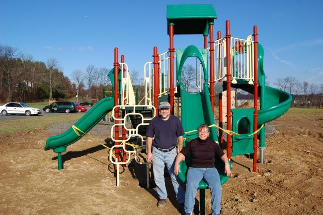 LINDA KOEHLER/TIMES NEWS Jack and Judy Breidinger (chairman of the Ross Township Park Committee) of Saylorsburg were part of the group of volunteers who erected this latest playground piece to the VanBuskirk/Haney Park located next to the Ross…
