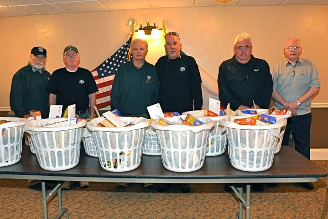 "VICTOR IZZO/SPECIAL TO THE TIMES NEWS Members of Jim Thorpe's AOH ""Alec Campbell, Mauch Chunk Division No. 1"" who helped prepare and deliver Thanksgiving Day food baskets last Saturday are, left to right : Dan Evans, vice president; Hugh Dugan; Matt…"
