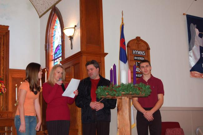 LINDA KOEHLER/TIMES NEWS The Cramer family, left to right, Kristin, Karen, Randy and R.J., lights the first candle on the first Sunday of Advent at St. Matthew's UCC in Kunkletown. The Advent wreath is a Christian tradition that includes the…