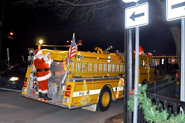 VICTOR IZZO/SPECIAL TO THE TIMES NEWS Santa and Mrs. Claus traveled to Josiah White Park on a fire truck from the Diligent Hose Company courtesy of the Jim Thorpe Fire Department.