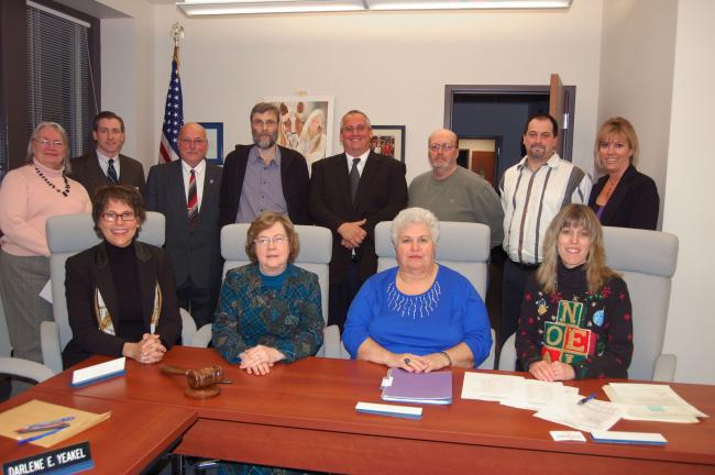 TERRY AHNER/TIMES NEWS School directors sworn in during Palmerton Area School Board's reorganizational meeting on Monday include (front row, l-r) Susan Debski, Darlene Yeakel, Carol Dwyer, Tina Snyder (back row, l-r) Barry Scherer, president (third…