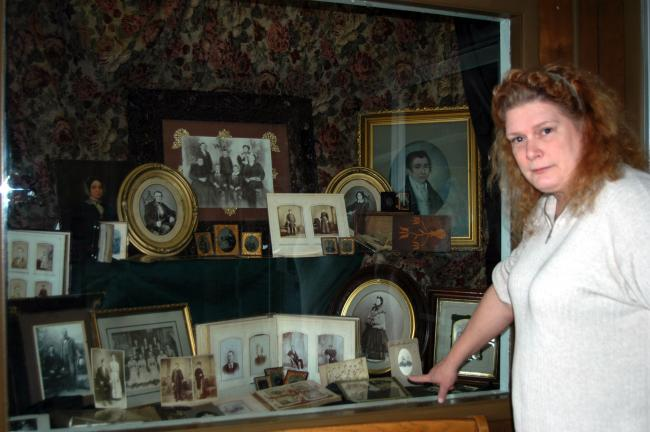 DONALD R. SERFASS/TIMES NEWS Genealogist Samantha Gibbons, Tamaqua, explains some of the highlights of a family lineage display she created for the 75th anniversary of the Tamaqua Public Library. The two-part exhibit at the South Railroad Street…