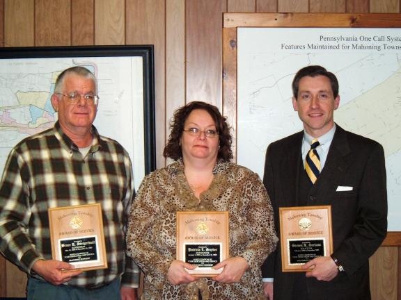 DAVID WARGO/SPECIAL TO THE TIMES NEWS Outgoing officials in Mahoning Township were recognized and given plaques for years of service by Mahoning Township. Those leaving include (left to right): Supervisors Bruce Steigerwalt and Chairperson Pat…