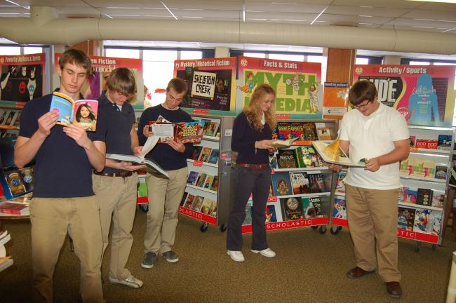 JOE PLASKO/TIMES NEWS Tamaqua students (from left) John Perla, Nick Minehan, Geoff Sincavage, Brooke Gursky and Drew Bonner check out some of the books available at the Scholastic Book Fair and Family day.