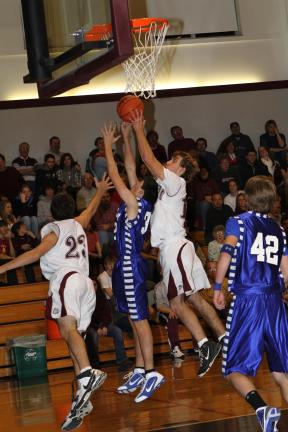 Special to the TIMES NEWS Lehighton's JT Keer and Alex Matika (23) battle Palmerton's Ben Andrews for a rebound.