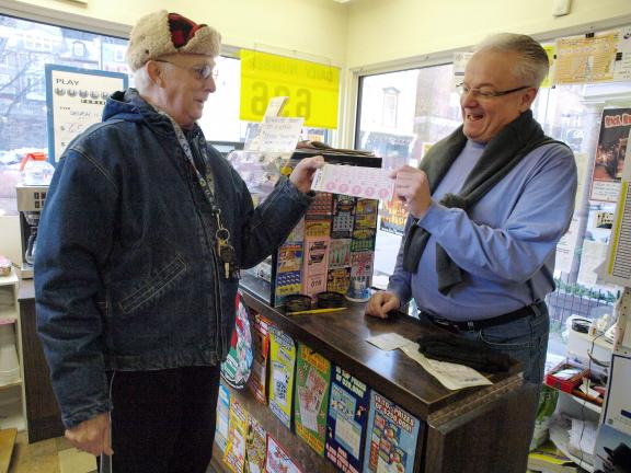 AL ZAGOFSKY/SPECIAL TO THE TIMES NEWS Richard Teates of Jim Thorpe purchases a Lottery Powerball ticket as Jack Dugan of Dugan's Store in Jim Thorpe asks him if he is the holder of a Pennsylvania Lottery Powerball ticket sold at the store for the…