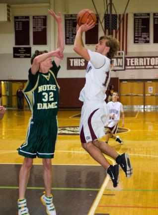 bob ford/times news Lehighton's JT Keer (right) pulls up with a jump shot as Nick Lewis of Notre Dame defends.