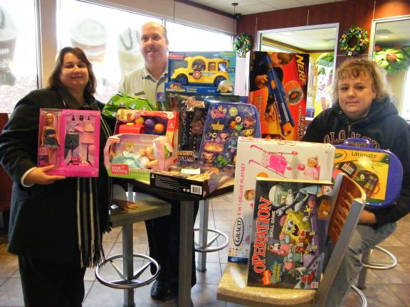 CAROL ZICKLER/SPECIAL TO THE TIMES NEWS Holding just part of the wonderful gifts bought for the Angel Tree at McDonald's in Nesquehoning forfifteen famlies are Bertha Shreffler of Meed's Methodist Church, Todd Sheckler, manager of McDonald's, and…