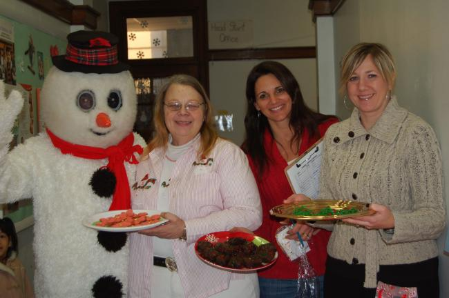 LINDA KOEHLER/TIMES NEWS Frosty the Snowman, Noraine (Grandma) McGee of Grandma's Bakery and Cafe, (cookie judge) Lori Malsch, SS Peter and Paul School volunteer and Lisa Palfey of sugarlily cookie company (cookie judge) thought the entries for the…