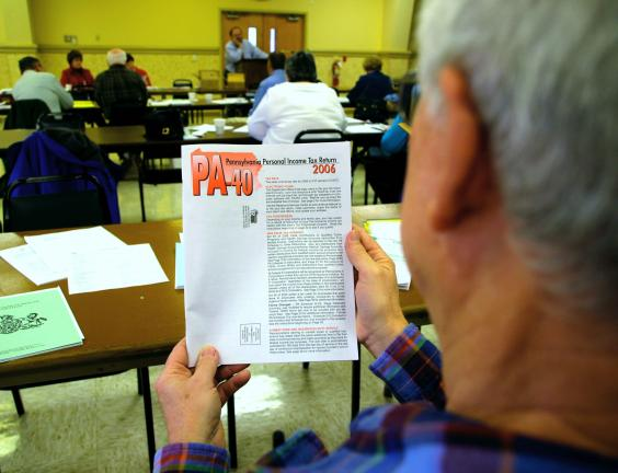 AL ZAGOFSKY/SPECIAL TO THE TIMES NEWS At last year's AARP Tax-Aide Program training workshop, a volunteer studies the Pennsylvania tax form as Allan Hild, the Carbon County District Coordinator for AARP's Tax-Aide Program explains how to complete it.