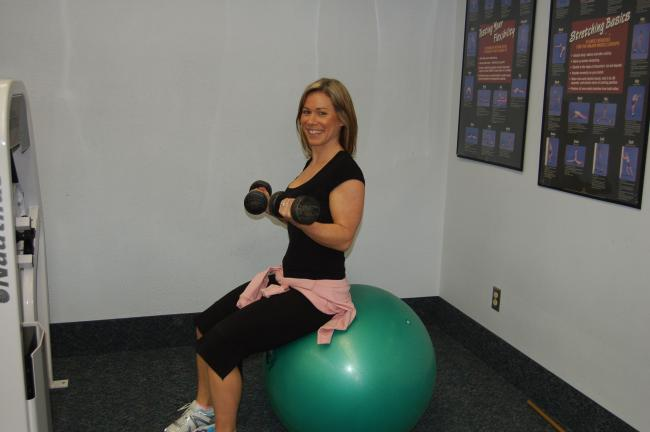 TERRY AHNER/TIMES NEWS Julie Reichl, manager/certified personal trainer, demonstrates several forms of exercise members can partake in at the Palmerton Fitness Center.