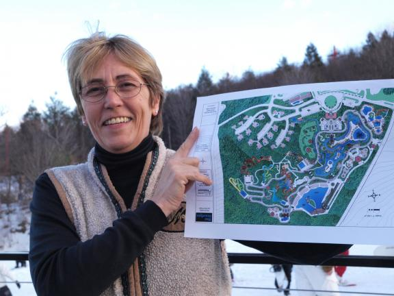 AL ZAGOFSKY/SPECIAL TO THE TIMES NEWS Barbara Green, one of the owners of Tuthill Corporation, the operator of Blue Mountain Ski Resort, holds a plan of its waterpark with its first phase set to open in 2012. The Carbon County-themed waterpark will…