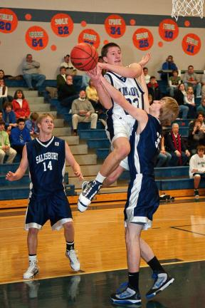 steve shinko / special to the times news Tamaqua's Michael Taylor goes up for two as Salisbury's Mike Schantz defends. Looking on is Salisbury guard Jake Kovach (14).