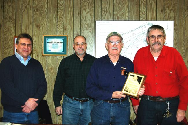 DONALD R. SERFASS/TIMES NEWS  Newly seated Walker Township Supervisor William McMullen, left, joins fellow board members in thanking former supervisor Randall Bensinger, third from left, for his six years of dedication to the township. Second from…