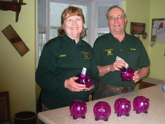 "SPECIAL TO THE TIMES NEWS Lion Adele Argot and Lion Charles Rush have begun delivering purple pigs to Region 1 Lions clubs. The pigs are symbols of each club's help in ""Feeding the Hungry."""