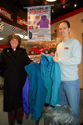 "Gail Maholick/TIMES NEWS The Rev. Nancy Moore, left, pastor of St. Matthew's Lutheran Church, Franklin Township, was one of the many people who dropped off coats for the ""Kids for Coats"" promotion at Mobile Edge, 52 Blakeslee Blvd., Lehighton…"