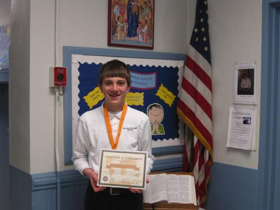 SPECIAL TO THE TIMES NEWS Ethan Vermillion, a seventh grade student at Our Lady of the Angels Academy, Lansford, has won the school-level competition of the National Georgraphic Bee contest.