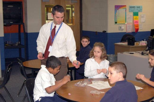 Tamaqua Elementary Principal Steven Behr assists second-grade students Emily Zuber, Anthony Martinez and Brandon Andescavage with creating clay seals during the class' distance learning session with the Alaska SeaLife Center.