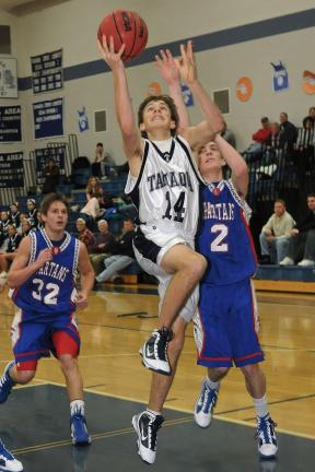Steve Shinko/Special to the TIMES NEWS Tamaqua's Joseph Rudy goes up for two in front of North Schuylkill defenders Stephen Ennis (2) and Kody Flail (32) during Tuesday's game at Tamaqua.