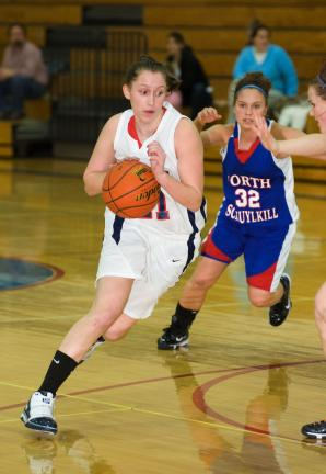 bob ford/times news Jim Thorpe's Brittany Holland (left) drives around North Schuylkill defender Carissa Rupinski.