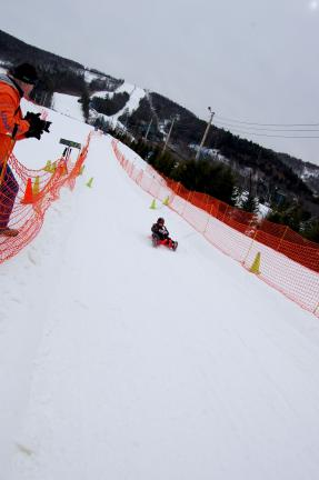Gail Maholick/TIMES NEWS Sebastian Buckley, 11, of Salisbury, slides down the slopes of Blue Mountain Ski Area as a Luge Olympic hopeful.