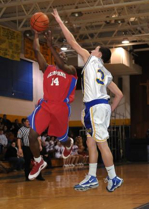 steve shinko/times news Marian's Chris Barletta tries to block a shot by Jim Thorpe's Jaquan Richardson during Wednesday night's basketball game at Marian.
