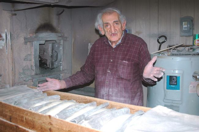 "DONALD R. SERFASS/TIMES NEWS ""There's no other place around here like this,"" explains Larry ""Mickey"" Padora. The Tamaqua man has been baking all-natural Italian bread using a coal-fired oven for well over 50 years."