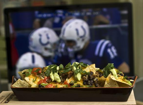 This photo taken Jan. 17, 2010 shows some nachos. Be sure your nacho offering at your Super Bowl gathering lives up to the hype of the game with these Super Nachos. (AP Photo/Larry Crowe)